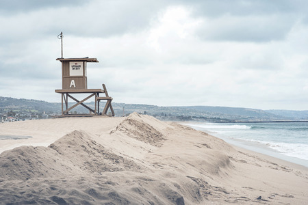 Stunning isolated beach scene, featuring a lifeguard tower and sand dunes. Stock Photo