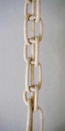 example of a knotted sailor's rope used to hang a lampshade from the ceiling Stock Photo