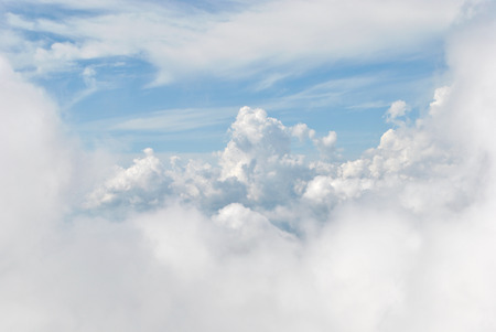puffy: White puffy clouds in the sky. View from top of mountain Stock Photo