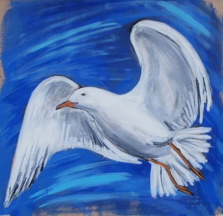 A seagull flying in the blue sky