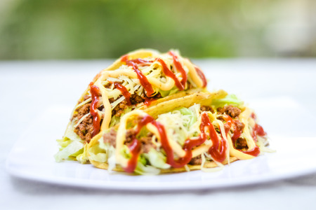 fried food: Delicious mexican taco With many types of sauces