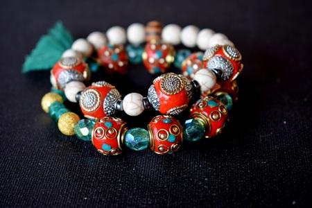Ethnic bracelets on dark background
