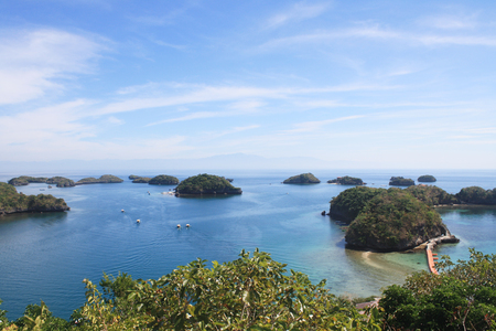 Boats sailing across group of islets small islands in beautiful blue waters and clear sky