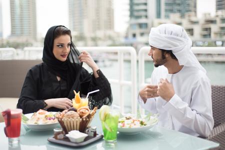 eastern: Arab Emirati Man and Woman Dining Outdoor