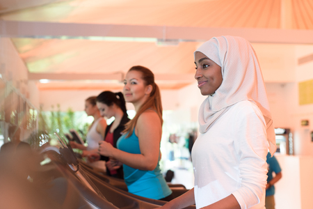 women sport: Muslim Girl in Gym Together With Other Ladies