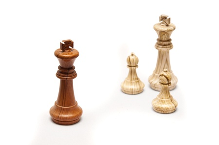 A dark king standing opposite a white king with two pawns