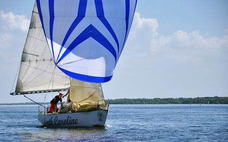Zaporozhye City, Ukraine - June 13, 2010 - A yachtsman standing on the boat during a regatta on the river Dnieper Editorial