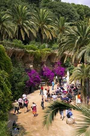 Barcelona, Spain, June 2011 - Many undefined people walk and enjoy the beauty of nature and sights in the Guell Park in Barcelona in the summer.