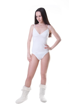 aside: A beautiful young woman in white underclothes with her hand on her waist thinking something over