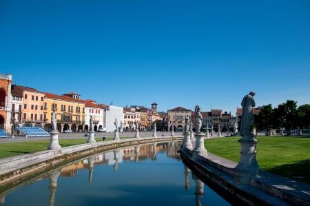 View of the canal with statues on prato della Valle in Padova, Veneto, Italy