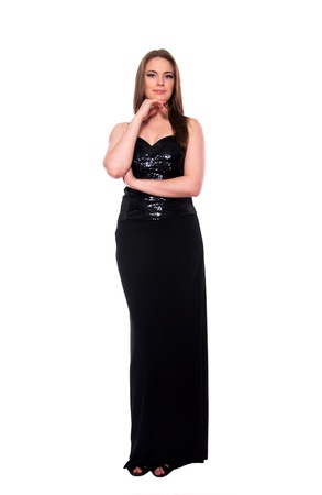 maxi dress: Beautiful young blond fashion female model wearing long black maxi skirt and black top, folding her arms on her chest and smiling at camera. Isolated on white
