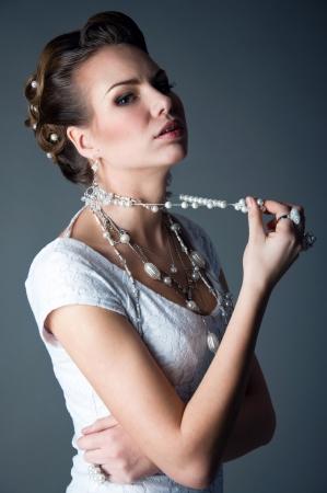 Portrait of young pretty fashion bride wearing elegant makeup