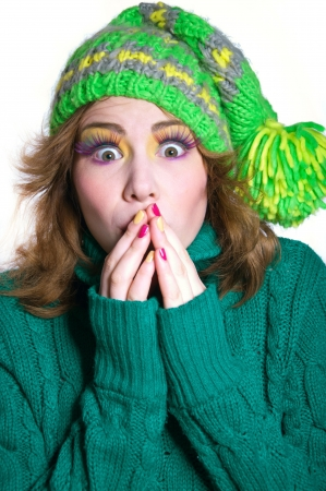 Young funny winter girl wearing green warm woolen knitted sweater