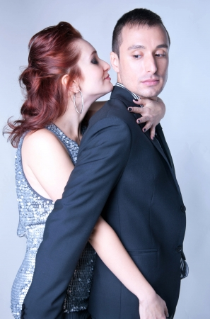 Studio portrait of sensual copule a man and a woman dressed in elegant clothes Stock Photo