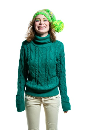 Young funny cute winter girl wearing green warm woolen knitted sweater
