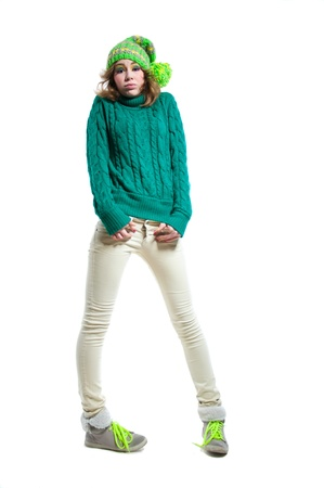 Full length portrait of young funny surprised winter girl wearing warm woolen knitted sweater Stock Photo - 17534342