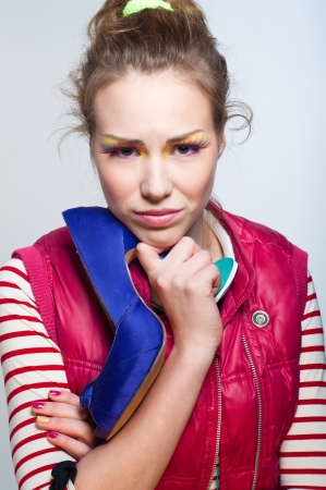 Pretty young downcast sad young girl wearing colorful casual style clothes Stock Photo - 17534337