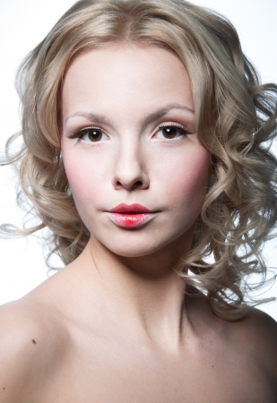 Glamour portrait of beautiful blond woman model with fresh daily makeup, romantic curly hairstyle,shoulders. Isolated on white Stock Photo - 17841540