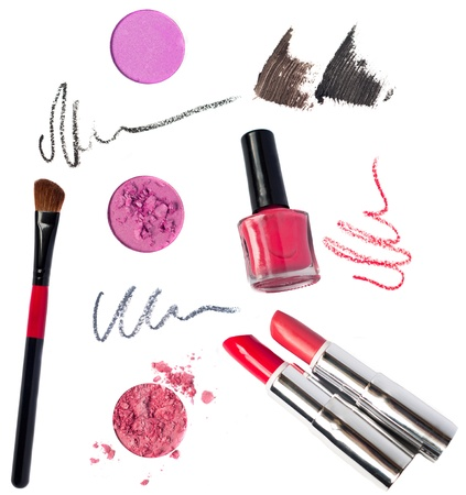 Still life of a small makeup kit light tender pink eyeshadow, red lip pencil photo