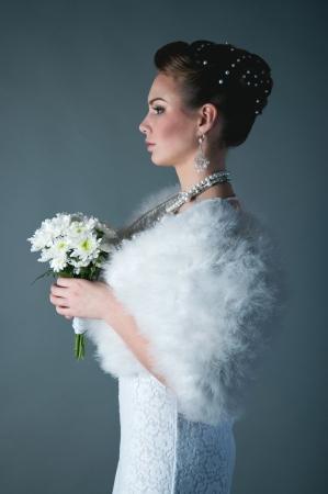 young pretty fashion bride wearing elegant makeup photo