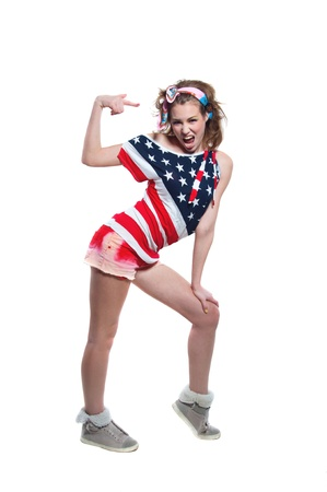 Full length portrait of young funny American patriotic girl wearing colorful pink blue head band, red shorts, off the shoulder top tank with USA flag, shouting loudly, pointing at herself. Isolated on white, copy space Stock Photo - 21895891