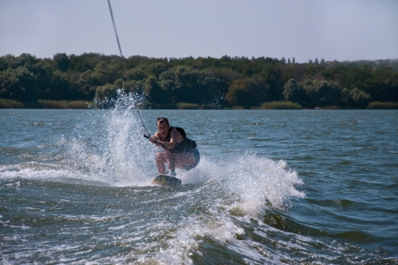 Wakeboard rider among water splashes photo