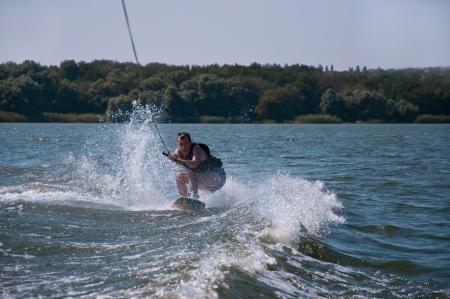 Wakeboard rider among water splashes Stock Photo