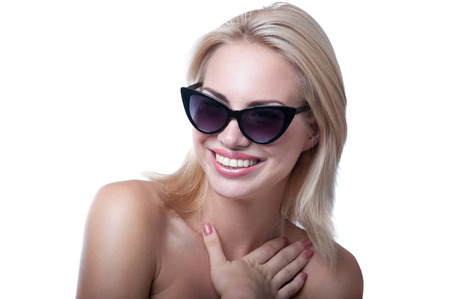 Funny beautiful young blond woman model wearing stylish black sun glasses photo