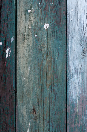 Green and blue old grunge wooden planks with some marks of white paint. Can be used as a background for web and print photo