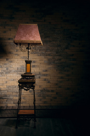 emty: Beautiful ortane stand lamp in emty room. Nice play of shadows on the wall Stock Photo