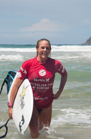 manly: MANLY AUSTRALIA - FEBRUARY 15: Happy Laura Enever leaving water after  the competition among women in the Australian Surfing Open at Manly Beach. February 15, 2015 Manly, Australia.