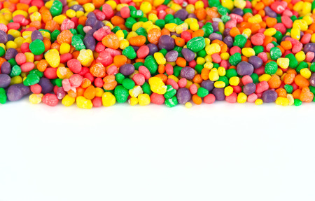 dragee: Multi color sugar dragee candies. Selective focus, main focus on the center. Copy space at bottom. Can be used as a background or header Stock Photo