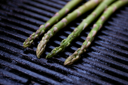 Fresh tender green asparagus cooked on grill. Copy space, editorial style