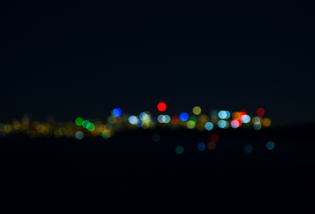 electricity background: Colorful blurred bokeh lights on black background