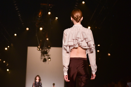 ruche: SYDNEY  AUSTRALIA - 17 May: Model walks on runway during Bianca Spender female fashion collection during Mercedes Benz Fashion Week Australia on 17 May 2016 in Carriageworks Sydney. Details of a blouse Editorial