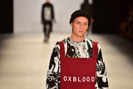 oxblood: SYDNEY  AUSTRALIA - 20 May: Model walks on runway during Oxblood show at The Innovators fashion design studio during Mercedes Benz Fashion Week Australia on 20 May 2016 in Carriageworks Sydney Editorial
