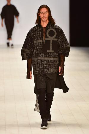 pragmatic: SYDNEY  AUSTRALIA - 20 May: Model walks on runway during Mandem show at The Innovators fashion design studio during Mercedes Benz Fashion Week Australia on 20 May 2016 in Carriageworks Sydney