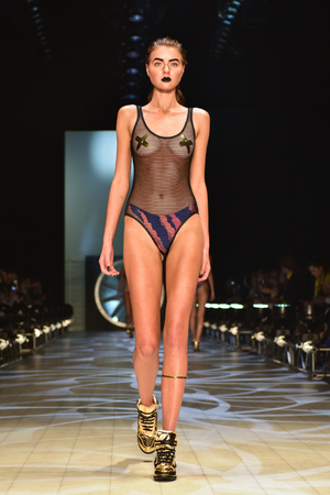 18 19: SYDNEY  AUSTRALIA - MAY 19: Model walks runway during We Are Handsome fashion show Mercedes Benz Fashion Week Australia on 18 May 2016 in Carriageworks in Sydney