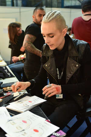 SYDNEY  AUSTRALIA - 20 May: Makeup artist creates samples of makeup for show before House of Cannon fashiob show at Mercedes Benz Fashion Week Australia on 20 May 2016 in Carriageworks Sydney