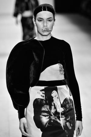 SYDNEY  AUSTRALIA - 20 May: Model walks runway catwalk during Kakopieros fashion show at Mercedes Benz Fashion Week Australia on 20 May 2016 in Carriageworks Sydney