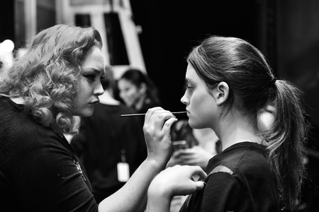 SYDNEY  AUSTRALIA - 20 May: Models stylists and makeup artists get prepared for show before Raffles International Showcase at Mercedes Benz Fashion Week Australia on 20 May 2016 in Carriageworks Sydney