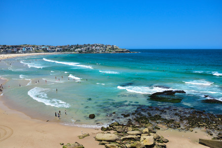 Busy famous Bondi beach on a bright summer day in Sydney New South Wales Australia