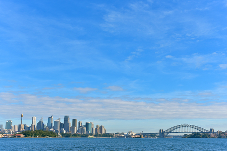 Sydney city skyline with famous Opera house, Westfield Tower, Harbour Bridge, Royal Botanic Gardens and other business skyscappers, copy space