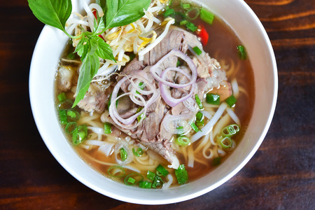 Fresh hot pho soup in a white bowl from traditional Vietnamese cuisine 版權商用圖片