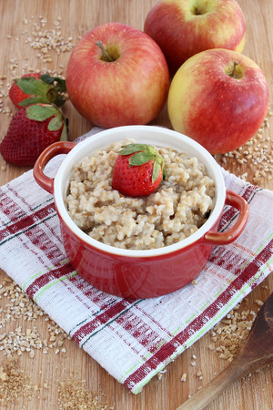 oatmeal: Oatmeal with apples and strawberries Stock Photo