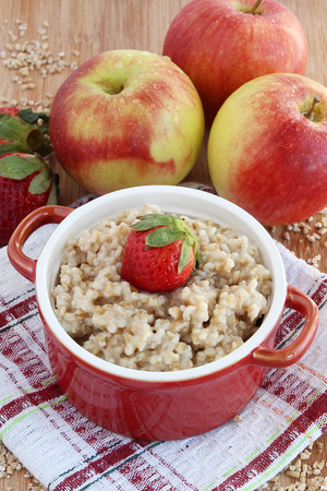 Oatmeal with apples and strawberries Reklamní fotografie