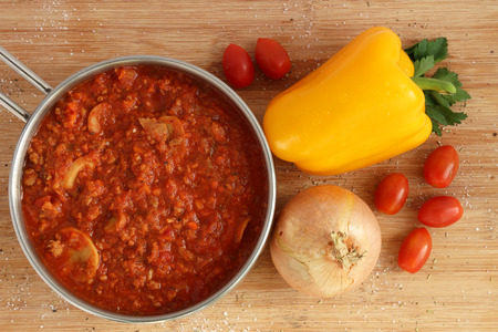 Bolognese sauce in pot with vegetables Stock Photo