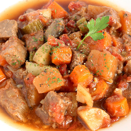 Beef stew in white bowl, close-up view photo