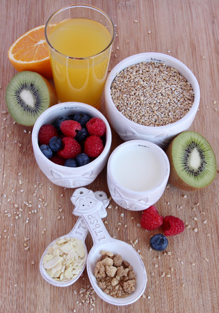 oatmeal: Uncooked oatmeal with various ingredients  fruit, milk, nuts, sugar