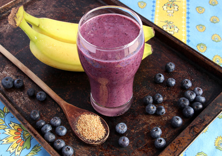 banana: Blueberry smoothie made with banana and ground flax seeds Stock Photo